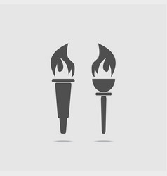 set of two torches with fire vector image