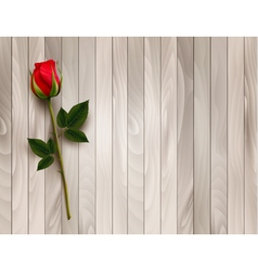 Single red rose on a wooden background vector image vector image