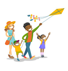 young multiethnic family playing with a kite vector image