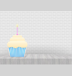 chocolate cupcake with burning candle stock vector image