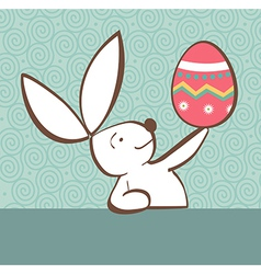 Easter bunny with painted egg vector