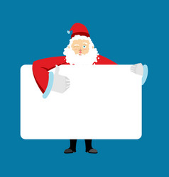 santa claus holding banner blank christmas vector image