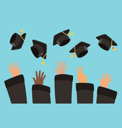 students throw graduation caps into air vector image