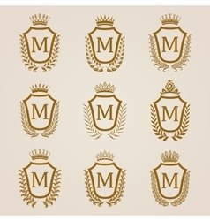 Golden shields with laurel wreath vector