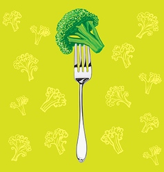 Green broccoli on a metal fork vector