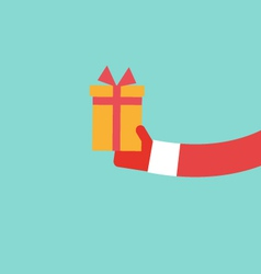 Santa Claus holds present flat design vector image