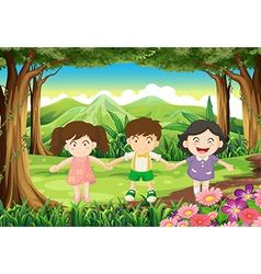 Three playful kids at the jungle vector image