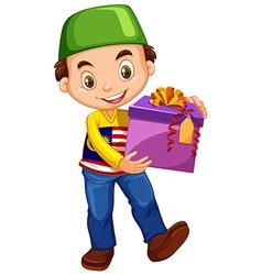 Muslim boy holding box of present vector