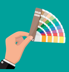 Color swatch color palette guide in hand vector