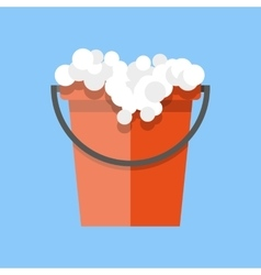 Red cleaning bucket with soap bubbles vector