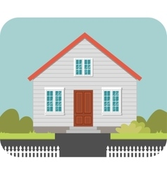 House with a white fence vector