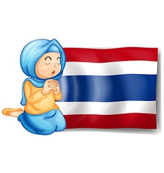 A muslim praying in front of the Thailand flag vector image vector image