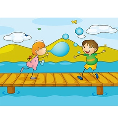 Kids playing at the bridge vector image vector image