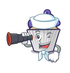Sailor with binocular blueberry cupcake mascot vector