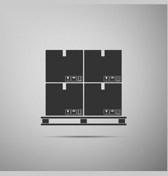 cardboard boxes on pallet icon isolated on grey vector image