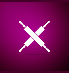 crossed rolling pins icon isolated on purple vector image