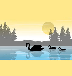 Silhouette of swan and tree on lake scenery vector