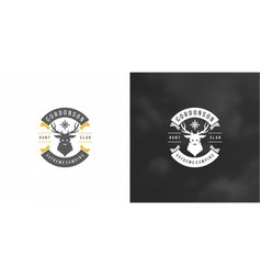 deer head with horns logo emblem vector image