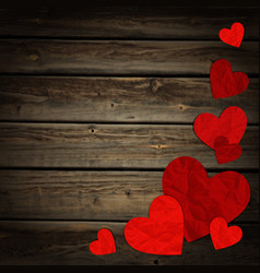hearts on the background of wood vector image