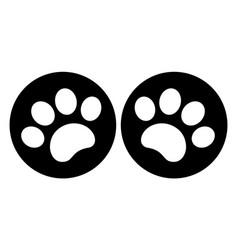 paw prints on a black circle symbol icon vector image