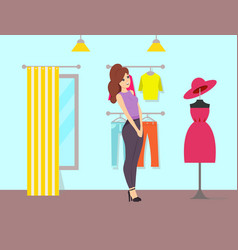 Woman admiring dress and hat on mannequin vector