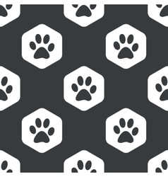 Black hexagon paw pattern vector