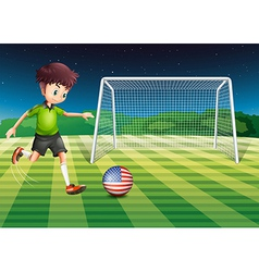 A player kicking the ball with the flag of USA vector image