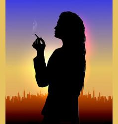 Girl smokes at sunset vector