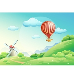 summer fields with a mill and a balloon in the s vector image