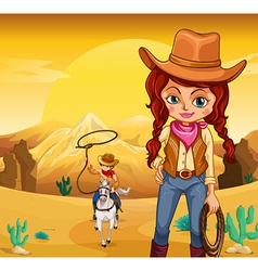 A cowboy and cowgirl at the desert vector