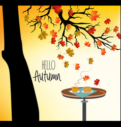 hello autumn with a cup of hot drink on the table vector image
