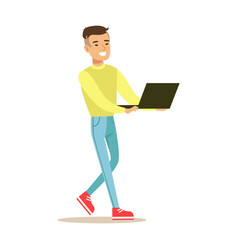 young smiling man standing and using laptop vector image