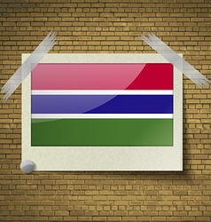Flags Gambia at frame on a brick background vector image