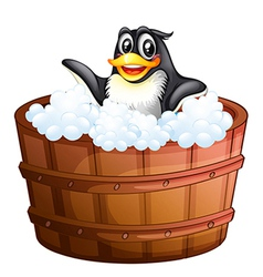 A penguin at the bathtub vector image