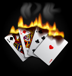 burning playing cards on black vector image