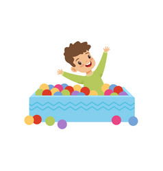 cute little boy playing in pool with colorful vector image