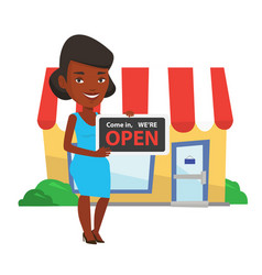 African shop owner holding open signboard vector