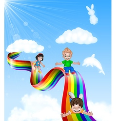 Cartoon little kids playing slide on rainbow vector image
