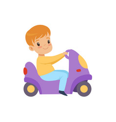 Cute little boy riding a toy motorcycle vector