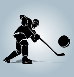 Silhouette of a hockey player with puck vector