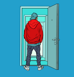 A teenage boy stands on threshold an open vector