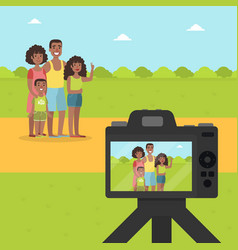 happy family posing for photographer in park vector image