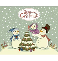The family of snowmen dresses up a fur-tree vector image