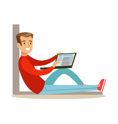 young man sitting on the floor with his laptop vector image