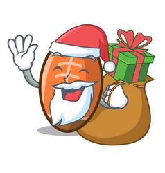 Santa with gift rugby ball mascot cartoon vector
