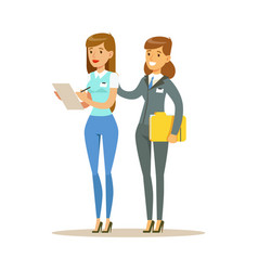two young woman working together in office vector image vector image
