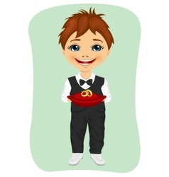Little boy holding wedding rings on cushion vector image
