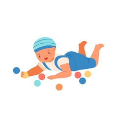 Baby boy lying and playing with colorful bright vector