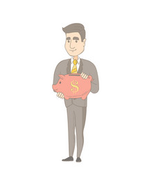 young caucasian businessman holding a piggy bank vector image