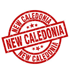 New caledonia red round grunge stamp vector